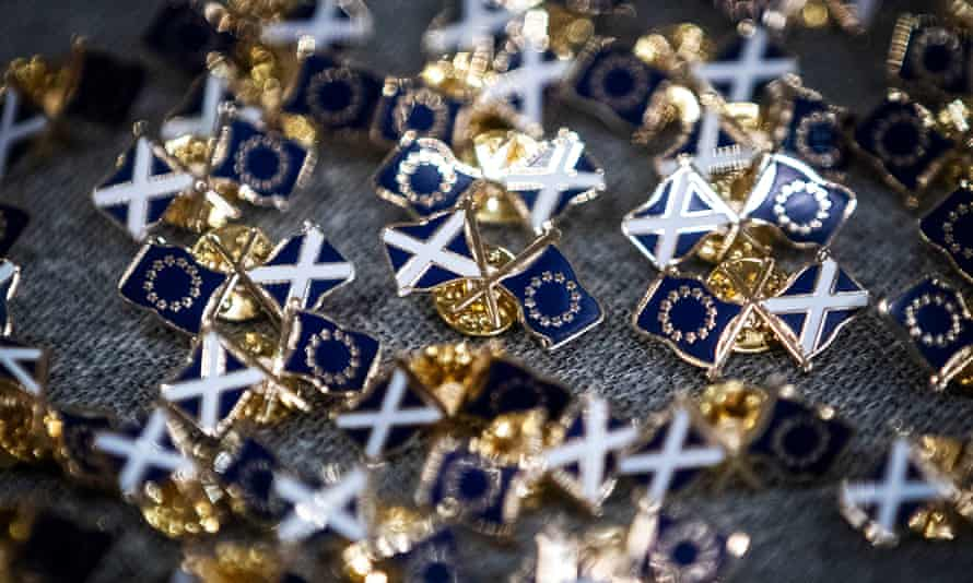 Pin badges showing the Saltire and EU flags at a Stay in Scotland event in Edinburgh.