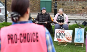 A pro-choice activist looks towards anti-abortion demonstrators outside the Marie Stopes clinic in Ealing, west London, in April.