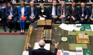 Theresa May listens to the Labour leader, Jeremy Corbyn