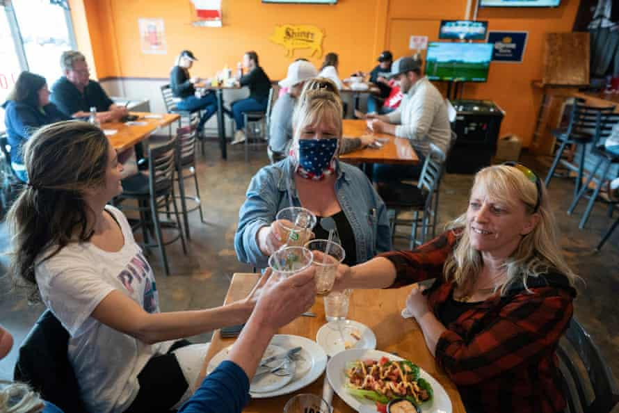 Friends Carrie Nasi left, Tracey, Cindy Colema and Lori Stayberg, met for food and drinks at Jonesy's Local Bar on the first day of the bar reopening in Hudson.