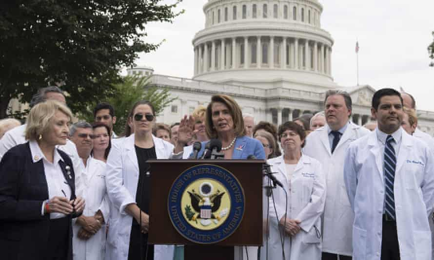 House Democratic leader Nancy Pelosi, of California, speaks alongside doctors, nurses and healthcare providers against the Republican bill.