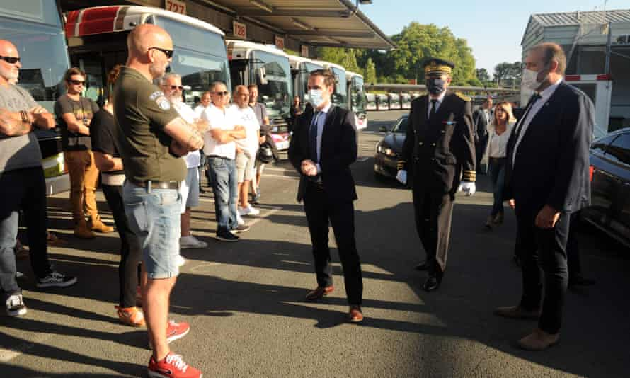 The French junior transport minister Jean-Baptise Djebbari meets bus drivers in Bayonne, south-west France, a day after the attack