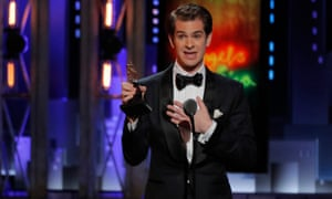 Andrew Garfield accepts the best performance by an actor in a leading role in a play award for Angels in America.