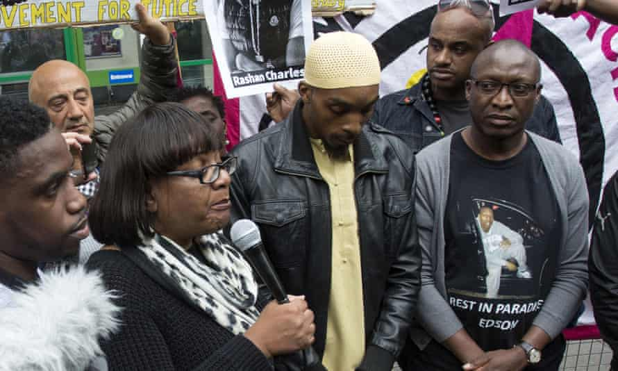 Diane Abbott joins the family of Edson Da Costa and Rashan Charles at a protest in Stoke Newington.