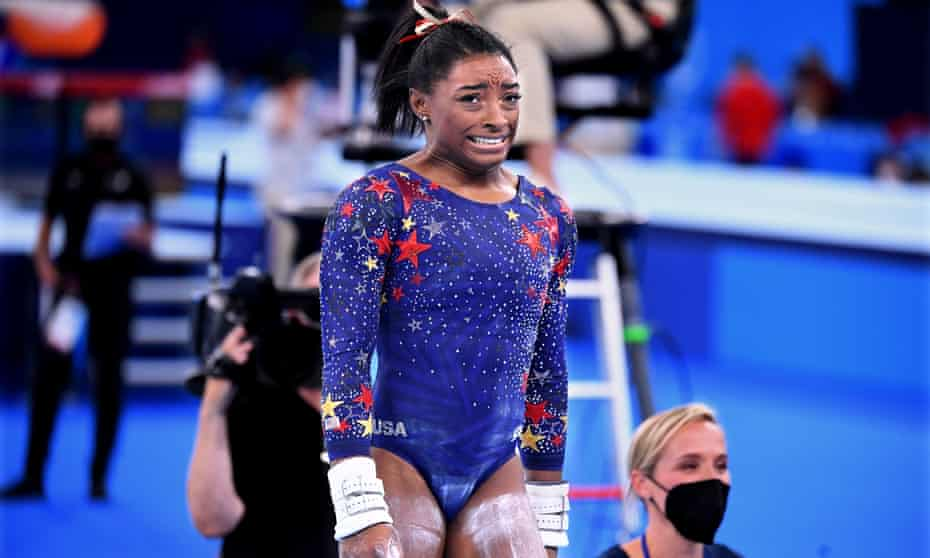 Simone Biles reacts after a challenging day for USA's gymnastics team