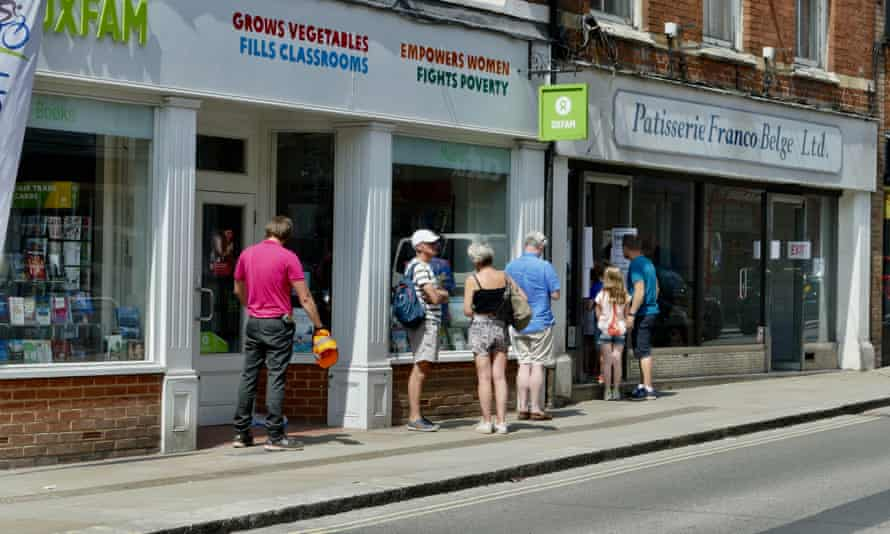 People outside a charity shop in Henley on Thames, Oxfordshire