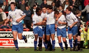 Andy Woodward, middle, celebrates with his Bury team-mates after a goal against Brentford in March 1997.