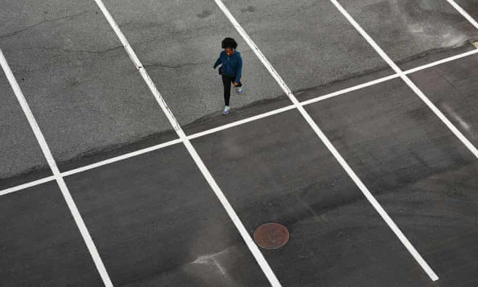 'This place is not for you' … a woman walks through an empty car park at a mall in Atlanta, Georgia.