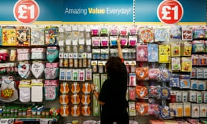 Poundland employee checking products in a store in London