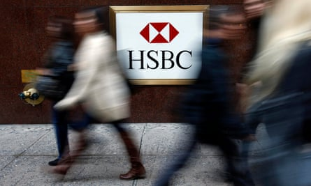 People walk past a HSBC bank branch in midtown Manhattan in New York City.