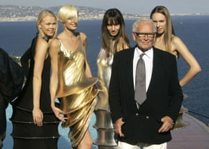 Cardin stands with models wearing his creations at his villa in Théoule-sur-Mer, southern France, 2008