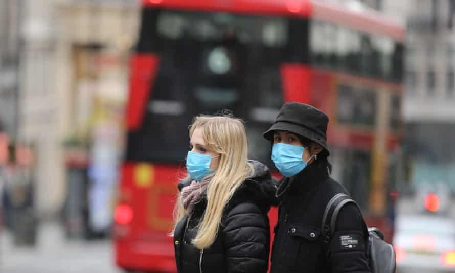People in central London wear medical masks as a precaution against coronavirus.