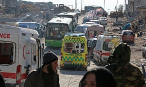Ambulances and buses in a rebel-held area of Aleppo, where an evacuation of the wounded has begun.