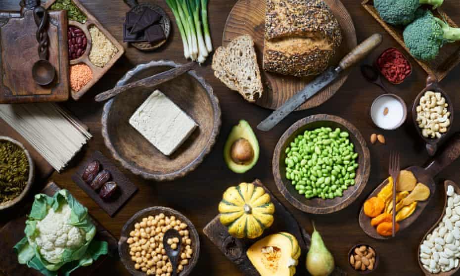 Vegan Food SelectionOverhead shot of healthy vegan food including fruit vegetables tofu and beans