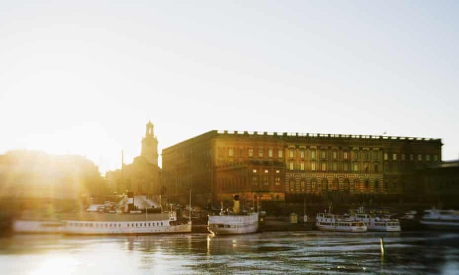 Sweden, Stockholm, Royal Castle, Waterfront at sunset.