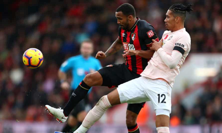 Callum Wilson of Bournemouth battles for possession with Chris Smalling of Manchester United.
