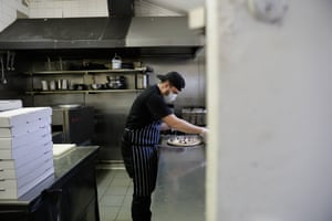 Chef Alvise Passarotto making pizzas in the kitchen of the Lady Hampshire