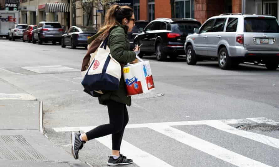 A woman carries groceries in New York, New York, on 22 March.