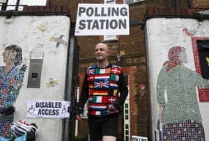 A man wearing a European themed cycling jersey leaves after voting at a polling station in north London