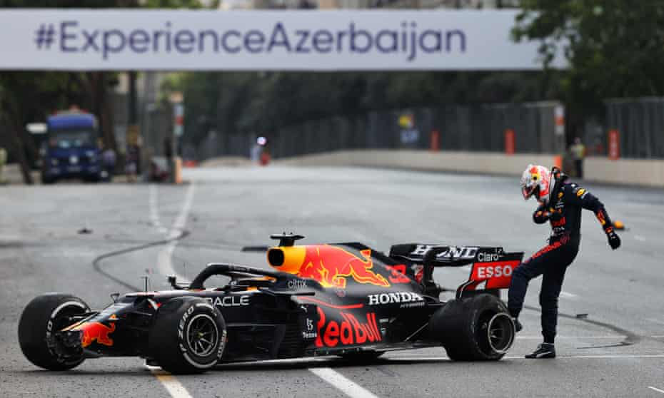 Max Verstappen kicks his tyre after crashing out of the Azerbaijan Grand Prix