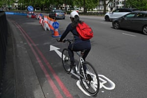 A cyclist makes use of a new expanded cycle lane on Park Lane in London.