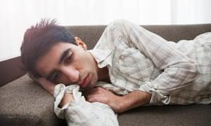 Young man lying on sofa