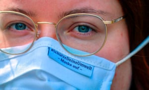 """Berlin, Germany A Greenpeace activist wears a mask with the slogan, """"protect the environment, wear your mask"""" during a protest at the Ministry for Food and Agriculture"""