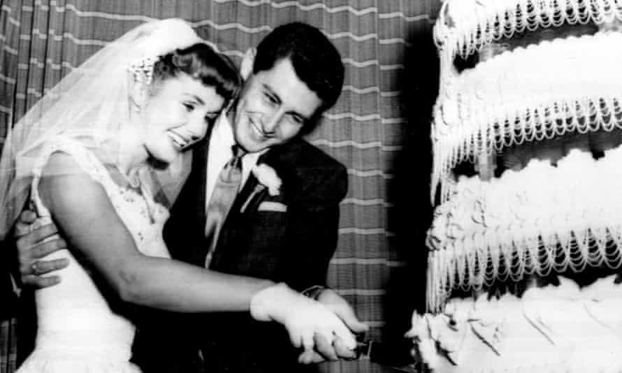 Debbie Reynolds and Eddie Fisher cutting their wedding cake, 1955.