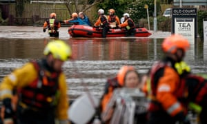 Firefighters rescue staff and residents from a care home in the village of Whitchurch on the banks of the River Wye.