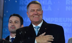 Klaus Iohannis addresses supporters at the ruling National Liberal party (PNL) headquarters in Bucharest on Sunday.