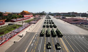 Armoured vehicles rolling through Tiananmen Square during the military parade.