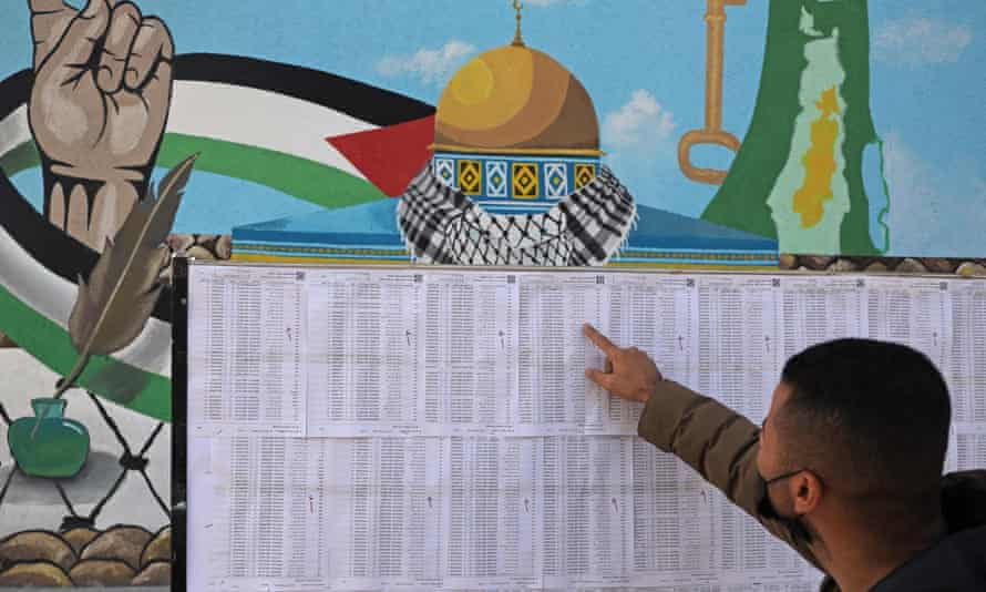 A Palestinian man looks for his name on the electoral roll, Gaza City, 3 March, 2021.