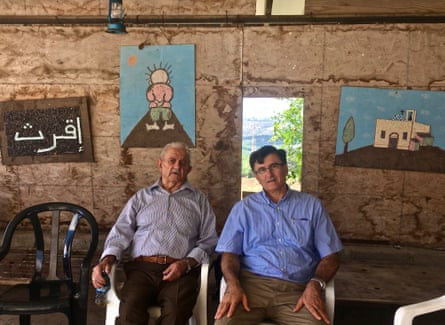 Ashkar winery owner Nemi Ashkar and his father, Maarof, 91 - who are both Christians - relax after monthly church prayers in Iqrit.