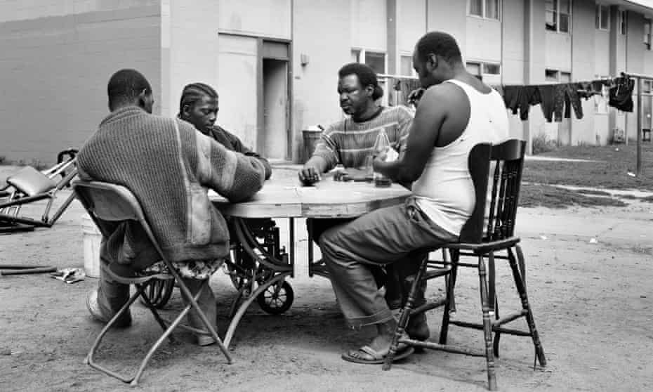 Men play dominoes at Imperial Courts in 1993