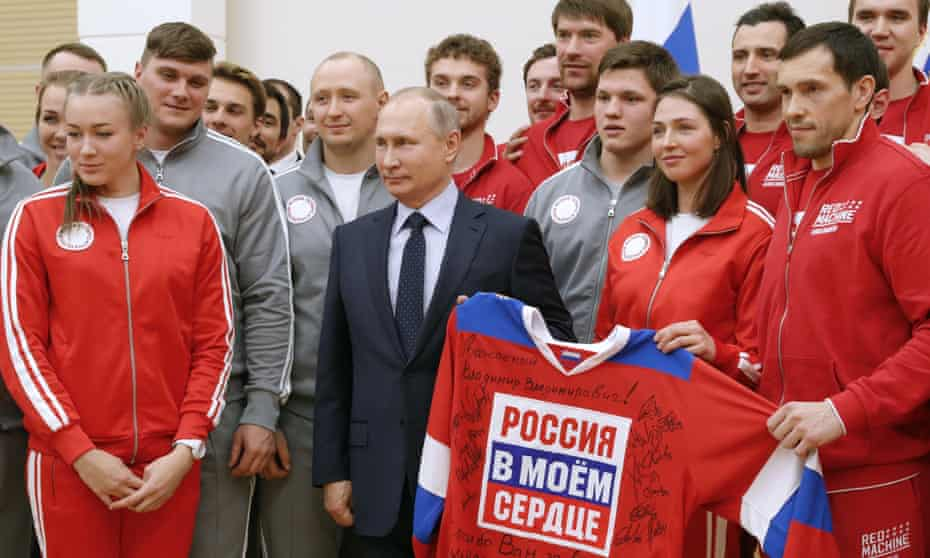 Vladimir Putin meets with the Russian athletes who are to compete in the Winter Olympic in Pyeongchang. A sign on the jersey reads 'Russia Is In My Heart'.