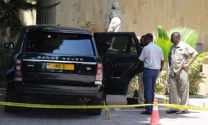 Tanzanian police officers inspect a vehicle belonging to Mohammed Dewji