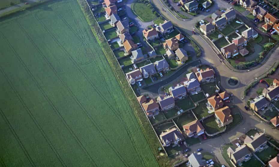 Aerial view of housing beside farmland near Northampton, UK.