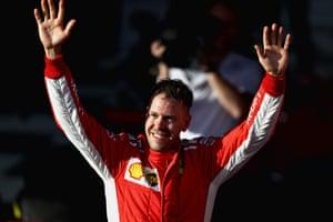 Race winner Sebastian Vettel of Germany and Ferrari celebrates after the Australian Formula One Grand Prix at Albert Park.