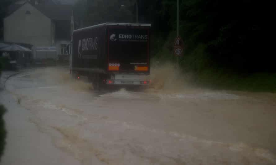 A truck drives through a flooded street in Hagen, western Germany.