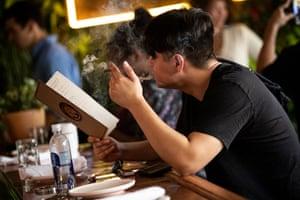 A customer studies the menu