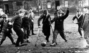 Boys play football in a Glasgow street in 1967.