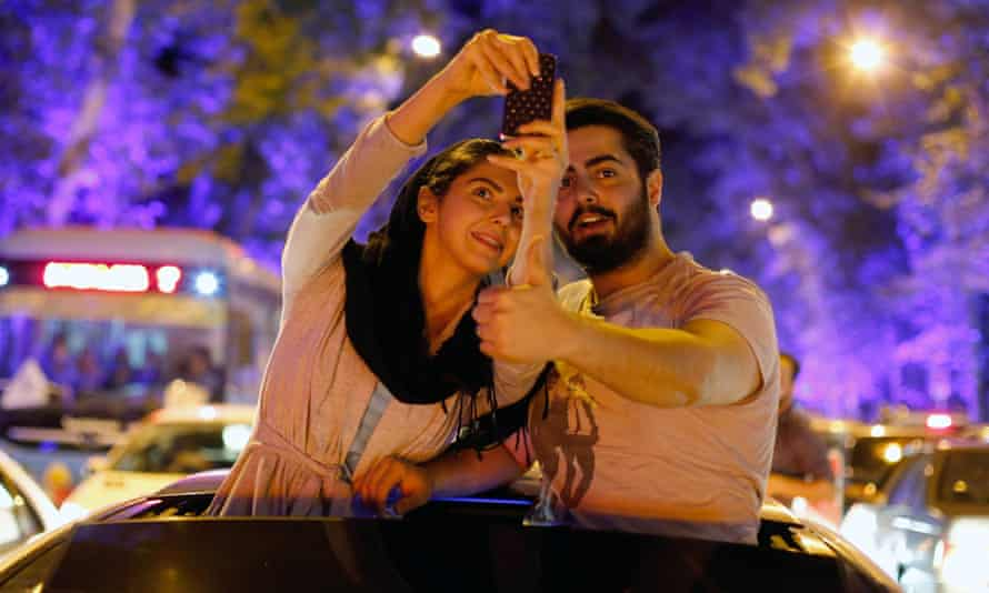 Iranians celebrate in the streets of Tehran after nuclear talks.