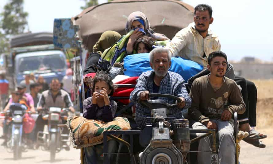Internally displaced people from Deraa arrive near the Israeli-occupied Golan Heights.