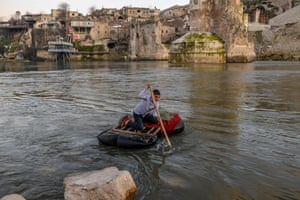 A boy goes fishing on the Tigris River near the abandoned old city of Hasankeyf. Despite years of protests, the small village will soon be under water as part of a controversial dam project