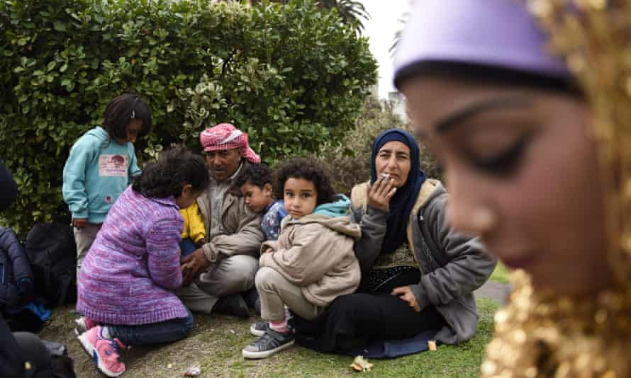 Syrian refugees gather outside the government house at Independence Square, in Montevideo.