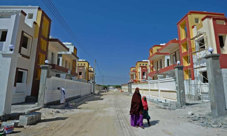 People walk through Daru Salaam city, a new housing estate in north Mogadishu.