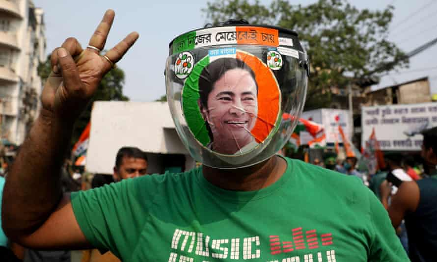 A supporter of Mamata Banerjee, who won a third term as chief minister of West Bengal, celebrates in Kolkata on Sunday.