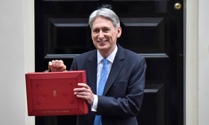 Philip Hammond holding the budget box as he leaves Downing Street