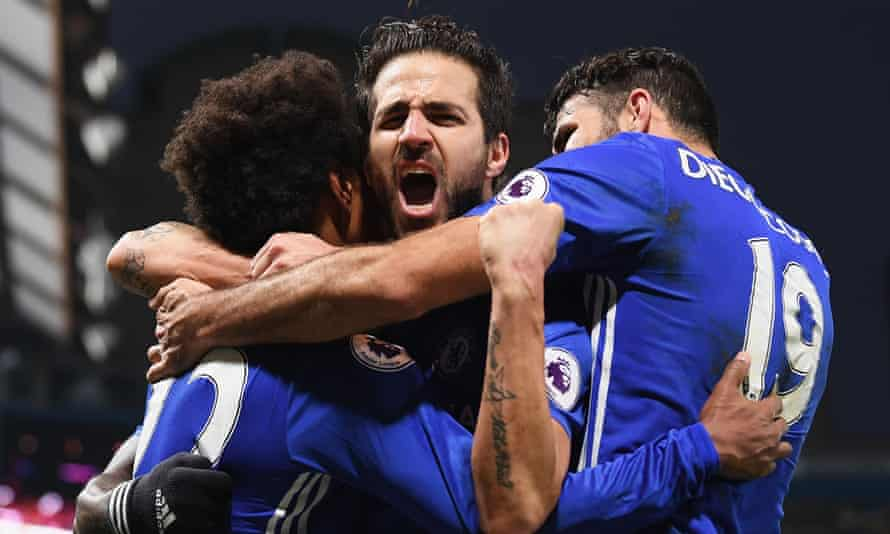 Cesc Fàbregas is at the centre of the celebrations as Chelsea beat Stoke to secure a 13th straight league win.