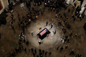 Members of the public pay their respects in the US Capitol Rotunda.